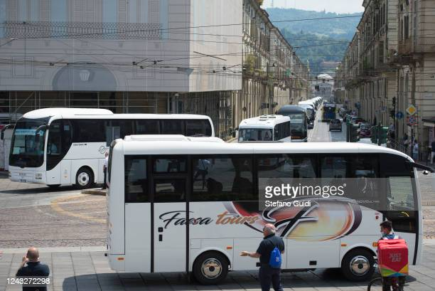 Parade of tourist buses in the streets of the center of Turin during the demonstrators protest of Bus Drivers against the Italian Government for the...