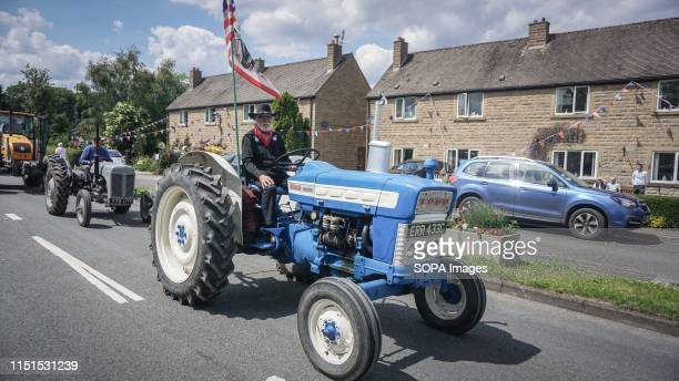 A parade of tractors during the carnival Hundreds of revelers across the all peak district took part in the annual carnival event Hope Wakes and Well...