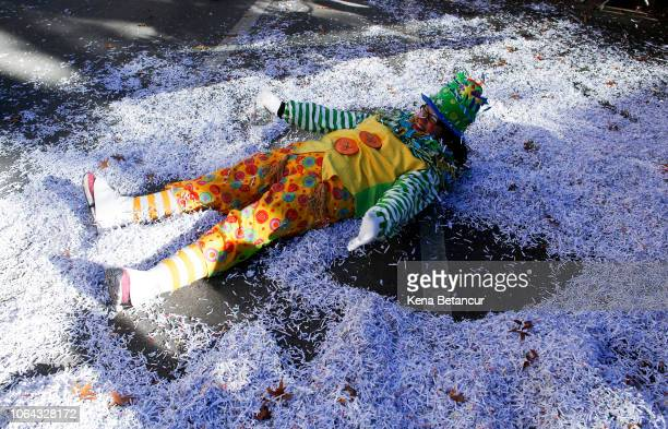 A parade participant makes a snow angel from confetti during the 92nd annual Macy's Thanksgiving Day Parade on November 22 2018 in New York City