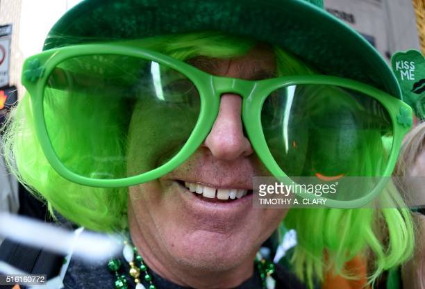 A parade participant poses on 5th Avenue during the 255th New York City St Patrick's Day Parade on March 17 2016 / AFP / Timothy A CLARY