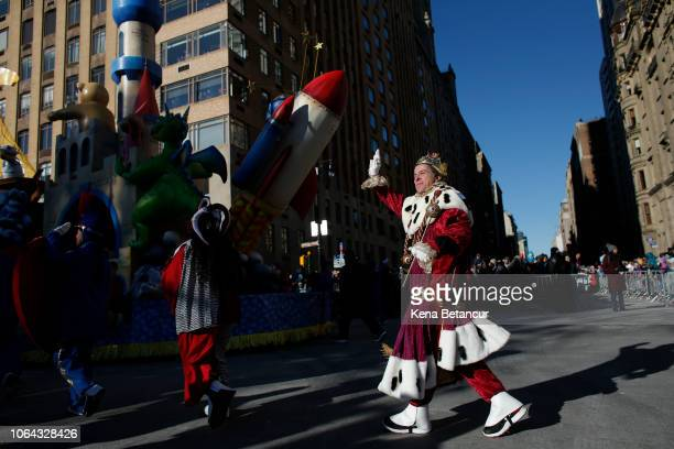 A parade participant waves to the crowd during the 92nd annual Macy's Thanksgiving Day Parade on November 22 2018 in New York City