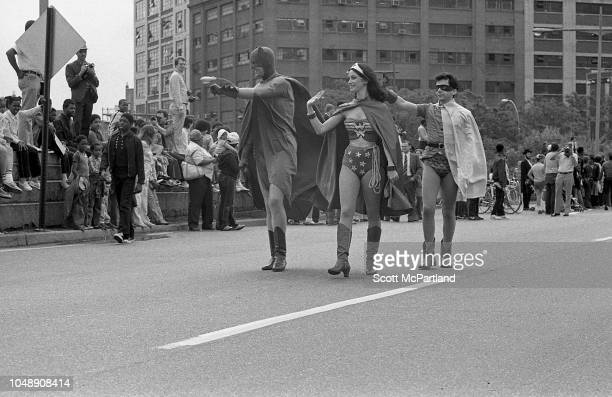 Parade participants dressed as Wonder Woman and Batman Robin cross the Brooklyn Bridge during its 100th birthday celebrations in Brooklyn New York...