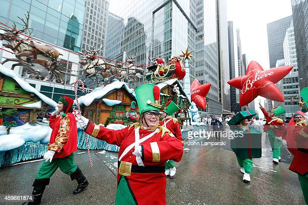 Parade participants dressed in Christmas character attire attend the 88th Annual Macys Thanksgiving Day Parade at on November 27 2014 in New York New...