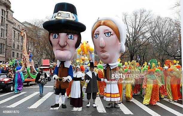 Parade participants dressed in Pilgrim costumes attend the 88th Annual Macys Thanksgiving Day Parade at on November 27 2014 in New York New York