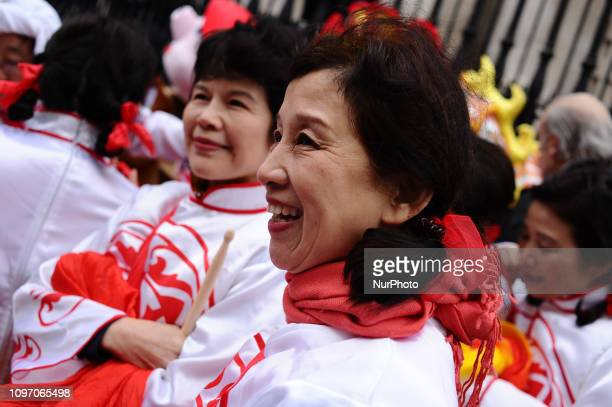 Parade participants get ready on Duncannon Street near Trafalgar Square ahead of the Chinese New Year Parade in London England on February 10 2019...