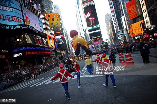 Parade participants guide a Ronald McDonald float through Times Square at the annual Macy's Thanksgiving Day Parade on November 27 2008 in New York...