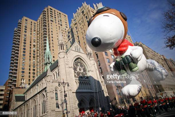 Parade participants guide a Snoopy float at the annual Macy's Thanksgiving Day Parade on November 27 2008 in New York City