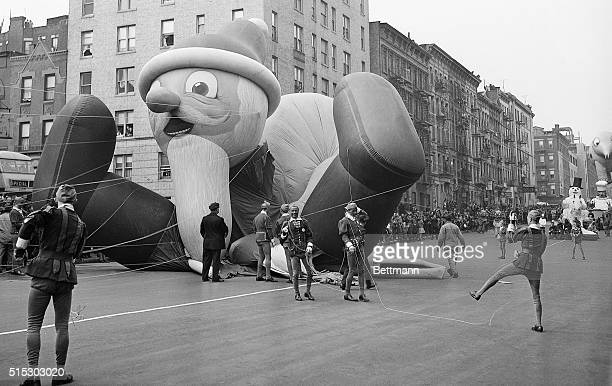 Parade participants hold ropes attached to the Santa Claus parade balloon as it collapses during the annual Macy's Thanksgiving Day Parade in New...