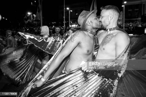 Parade participants kiss during the 2019 Sydney Gay Lesbian Mardi Gras Parade on March 02 2019 in Sydney Australia The Sydney Mardi Gras parade began...