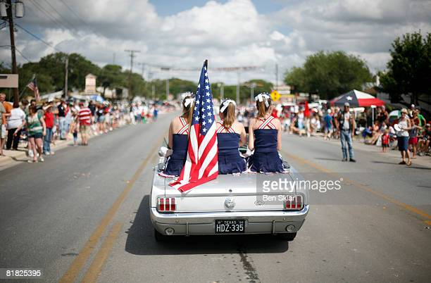 Parade participants make their way through town during the Independence Day parade July 4 2008 in Wimberley Texas The United States declared...