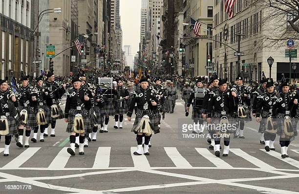 Parade participants make their way up 5th Avenue during the 252th New York City St Patrick's Day Parade on March 16 2013 AFP PHOTO/TIMOTHY A CLARY