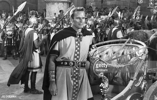 Parade Rest Charlton Heston as BenHur stands by chariot during victory parade in Rome in honor of Quintus Arrius a great naval hero BenHur MGM's...