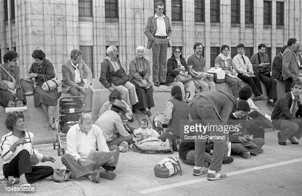 Parade spectators gather on the streets of Lower Manhattan during the Brooklyn Bridge's 100th birthday celebration New York New York May 24 1983
