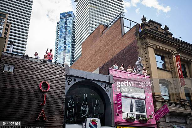 Parade spectators watch from Yonge Street rooftops at the annual Pride Festival parade July 3 2016 in Toronto Ontario Canada Prime Minister Justin...
