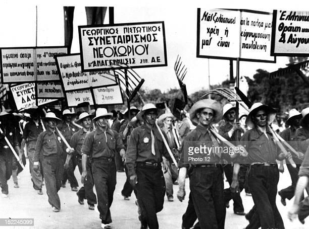 Parade under the dictatorship of General Metaxas Sign in the foreground 'You got us out of the mud out of our debts our gratitude is unbounded'...