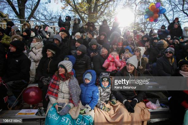 Parade watchers look on in heavy winter clothing due to cold temperatures during the 92nd annual Macy's Thanksgiving Day Parade on November 22, 2018...