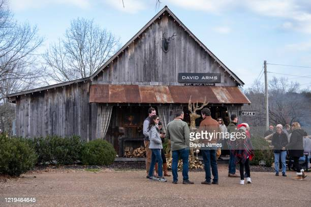 parade watchers outside david arms shop - brycia james stock pictures, royalty-free photos & images