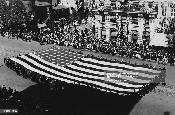 parade with big american flag - military parade stock pictures, royalty-free photos & images