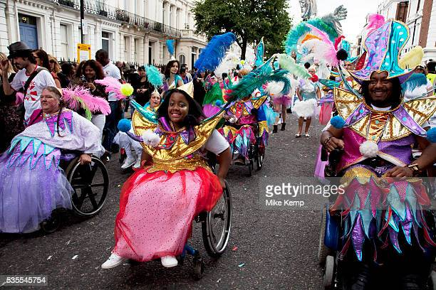 Parade with disabled people in fine costumes on the second day of the Notting Hill Carnival in West London The Notting Hill Carnival is an annual...