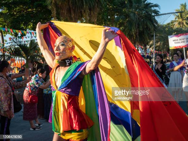pattaya, thailand - february 15, 2020: lgbt parade with people wearing rainbow color and wear collar writes the word pride cloth take part in pattaya international pride 2020, in pattaya, thailand on february 15, 2020 - pansexuality - fotografias e filmes do acervo