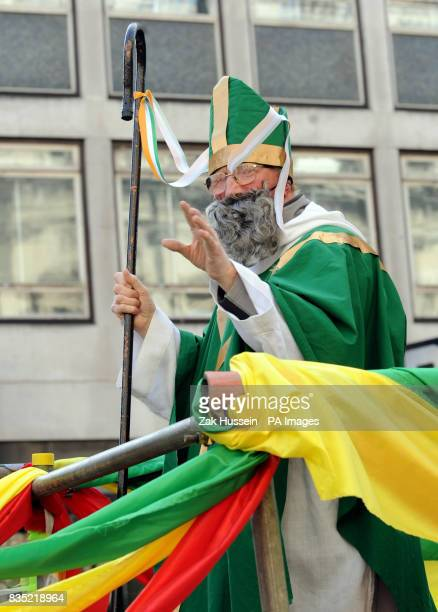 Parade-goer in costume dressed as Saint Patrick during the St. Patricks's Day parade in central London.