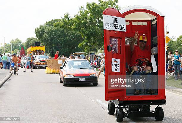 A paradegoer rides in an art car on Allen Parkway during the 26th Annual Houston Art Car Parade on May 11 2013 in Houston Texas