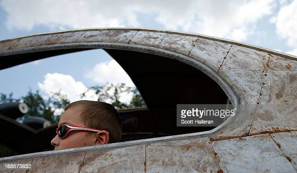 A paradegoer sits in an art car on Allen Parkway during the 26th Annual Houston Art Car Parade on May 11 2013 in Houston Texas