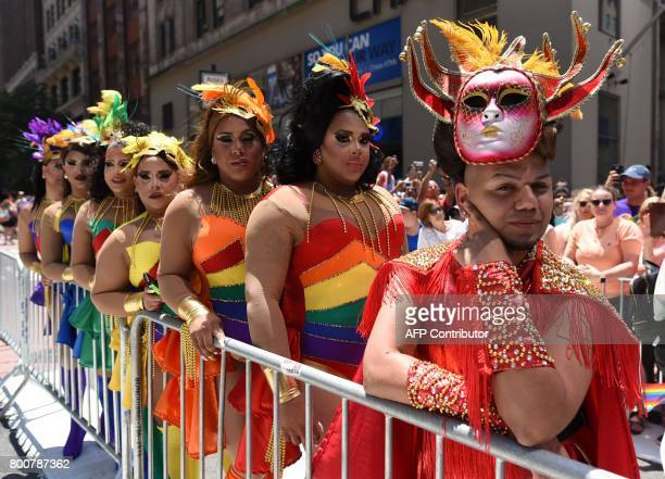 Parade-goers make their way down 5th Avenue during the NYC Pride March on June 25, 2017. The NYC Pride March celebrates its 48th annual parade . /...
