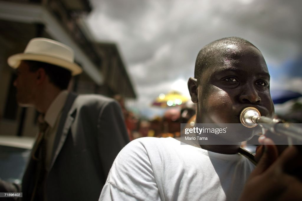 A parader plays his horn in the Satchmo Summerfest Second Line Parade August 6, 2006 in New Orleans, Louisiana.The festival honors jazz great Louis 'Satchmo' Armstrong and was moved this year to the French market area in the French Quarter from the Old U.S. Mint where it has been held in the past due to damage from Hurricane Katrina.
