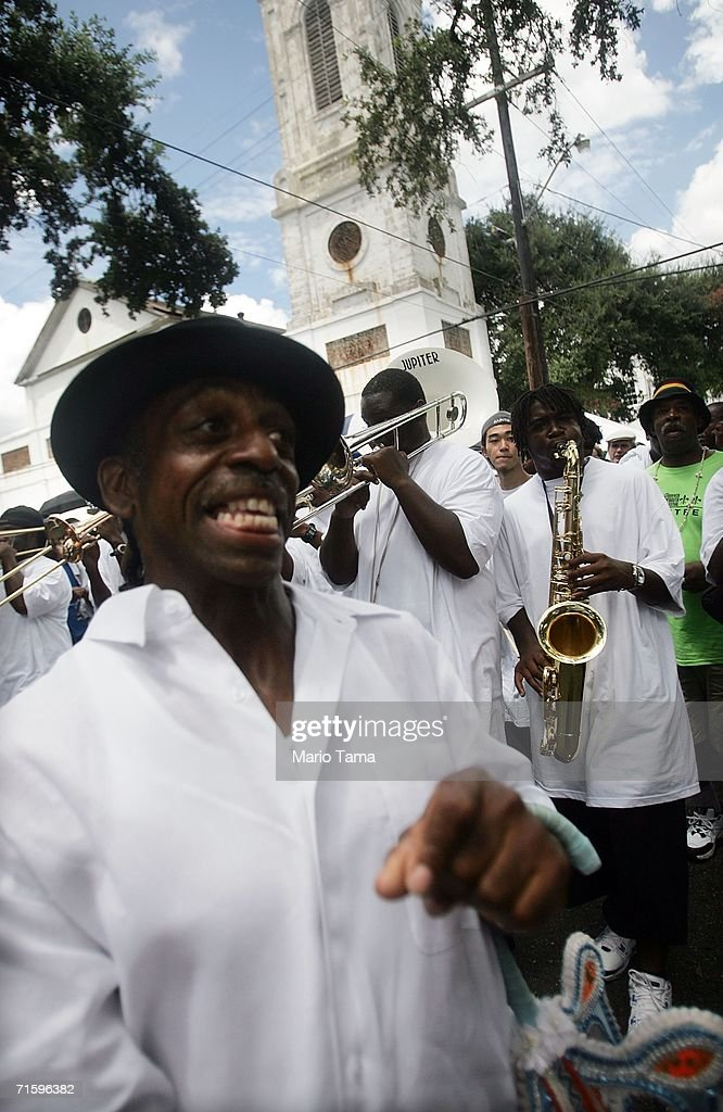 Paraders march in the Satchmo Summerfest Second Line Parade August 6, 2006 in New Orleans, Louisiana. The festival honors jazz great Louis 'Satchmo' Armstrong and was moved this year to the French market area in the French Quarter from the Old U.S. Mint where it has been held in the past due to damage from Hurricane Katrina.