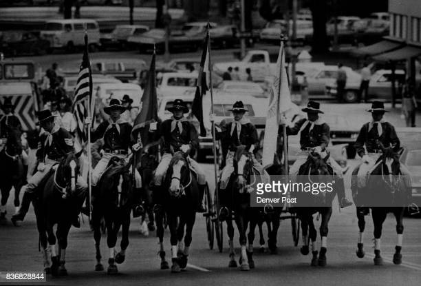 Parades Delivering Invitation to The Fair A line of mounted cavalry color guardsmen from Ft Carson Colo rides in parade from Currigan Exhibition Hall...