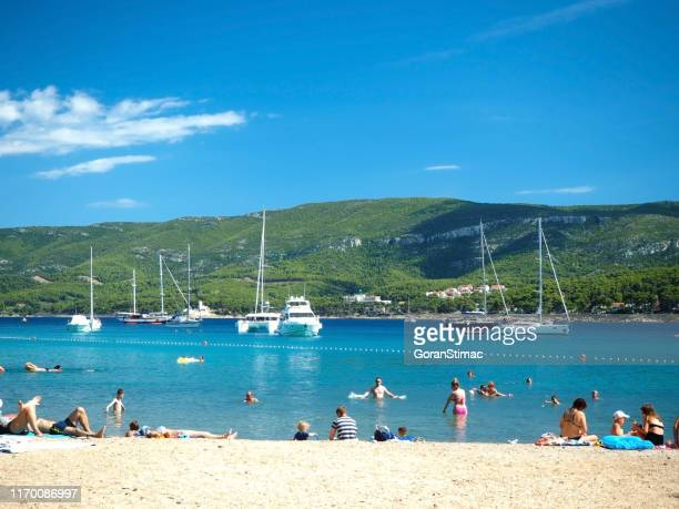 paradise hvar island beach - catamaran sailing stock photos and pictures