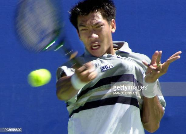 Paradorn Srichaphan of Thailand makes a return to Karol Kucera of the Slovak Republic 17 January 2000 in the first round of the Australian Open in...