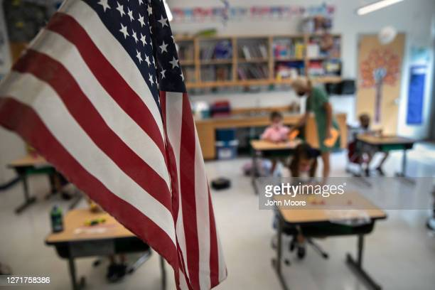 Paraeducator Kim Caruso helps Harper Shea , on her first day of kindergarten on September 9, 2020 in Stamford, Connecticut. For millions of...