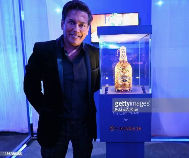 Parag Gupta with the bejewelled Chivas 18 bottle designed by jewelry designer Siddharth Kasliwal at the third edition of Chivas 18 Alchemy 2019 on...