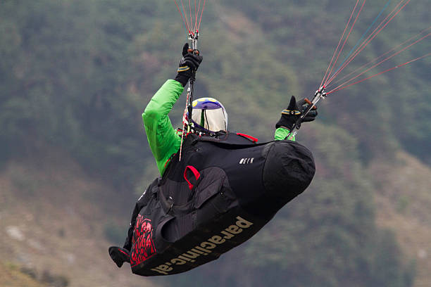 Paraglding pilot wearing full mask helmet during the Paraglider World Cup at Billing on Sunday The 2nd day task was called off due to bad weather...