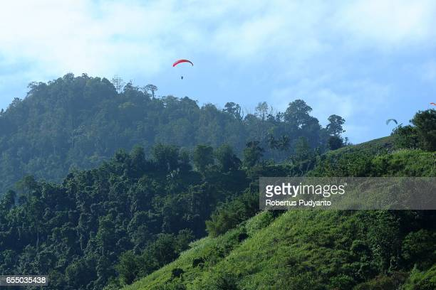 A paraglider competes during the Paragliding Accuracy World Cup 1st Series 2017 at Mount Tumpa on March 19 2017 in Manado Indonesia