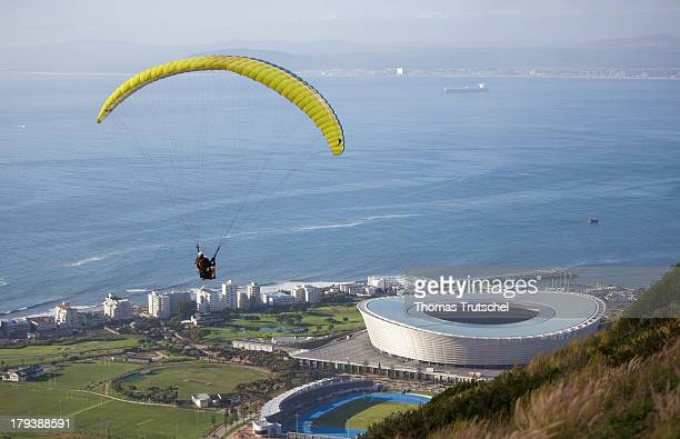 A paraglider descending over the Cape Town Stadium with a view of the sea in the background pictured on April 28 2013 in Cape Town South Africa