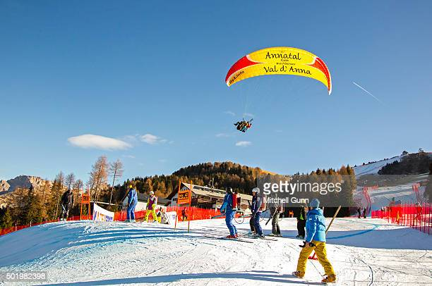A paraglider flies over the course before the downhill race at the Audi FIS Alpine Ski World Cup on December 19 2015 in Val Gardena Italy
