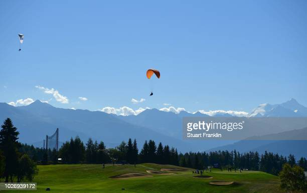 A paraglider flys over the seventh hole during the pro am prior to the start of the Omega European Masters at CranssurSierre Golf Club on September 5...