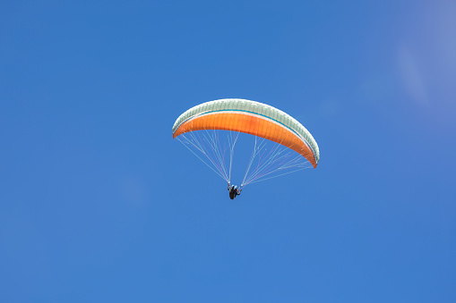 Paraglider in front of clear blue sky. - gettyimageskorea