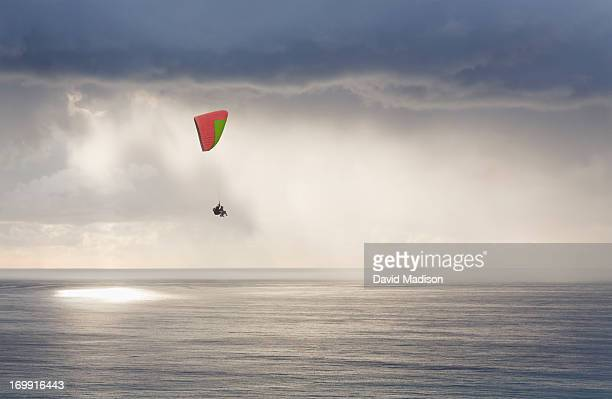 paraglider over pacific ocean - hgl stock pictures, royalty-free photos & images