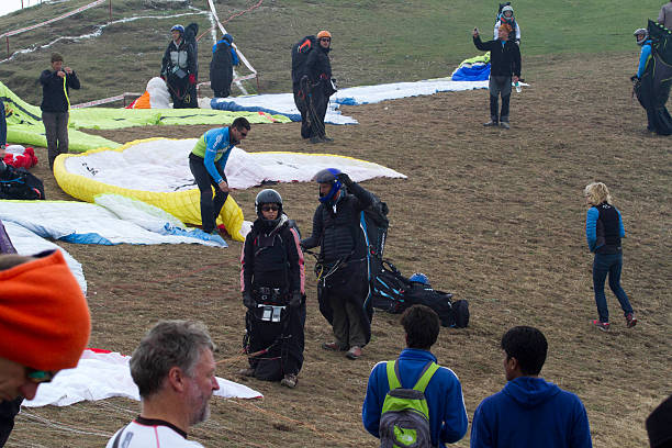 Paraglider pilot preparing to take off during the Paraglider World Cup at Billing on Sunday The 2nd day task was called off due to bad weather There..