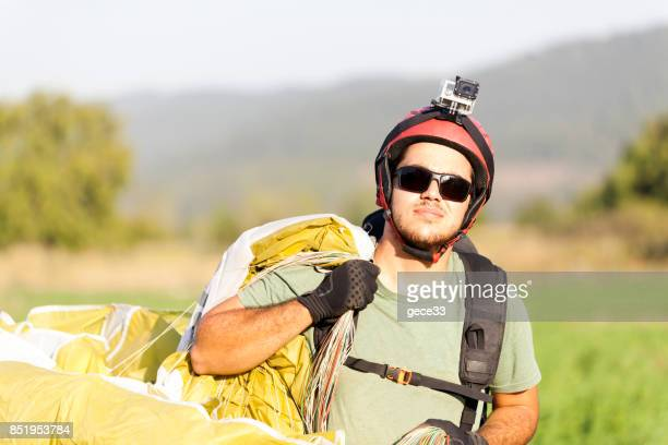 Paraglider Pilot Walking When After Landing