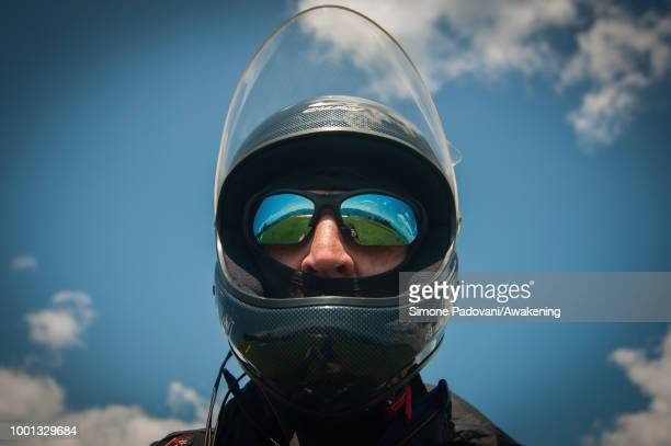 Richard Butterworth and another paraglider check the GPS devices at the takeoff area at Monte Avena before the training on July 18 2018 in Feltre...