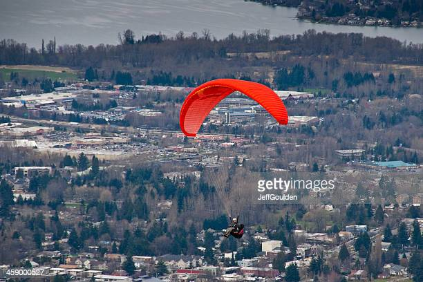 Paraglider Soaring Above Town