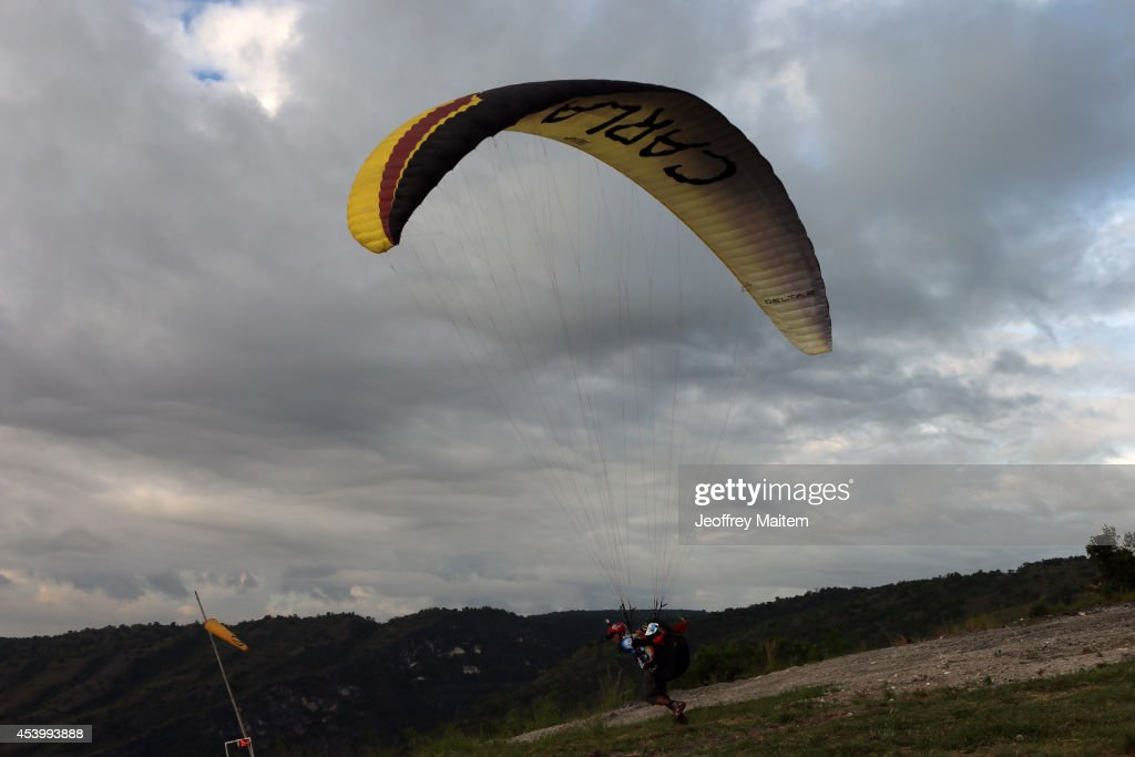 A paraglider takes off during the 1st International Paragliding