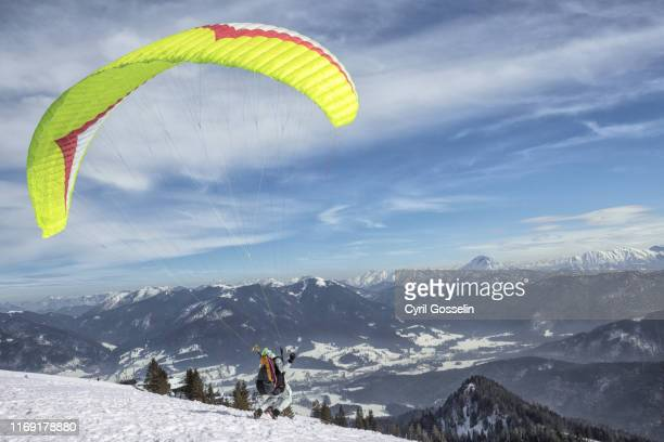 paraglider taking off - bayern stock pictures, royalty-free photos & images