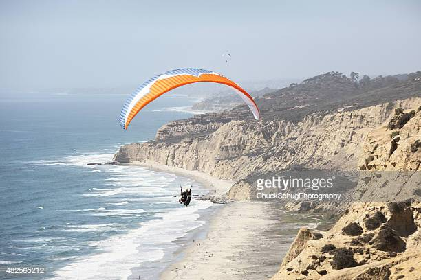 paraglider wing ocean flight - gliding stock photos and pictures