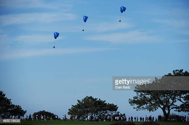 Paragliders fly over the Torrey Pines South course during the third round of the Farmers Insurance Open on January 25 2014 in La Jolla California